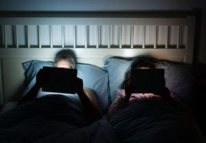 Be bold - turn off those devices and TV a few hours before bedtime.  Your partner may thank you!